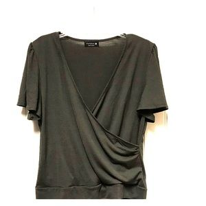 Very pretty dark olive blouse with tie back.